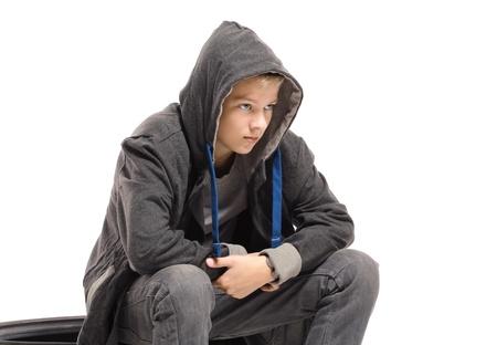 waif: Depressed teenage boy in a jacket. Isolated on white background  Stock Photo