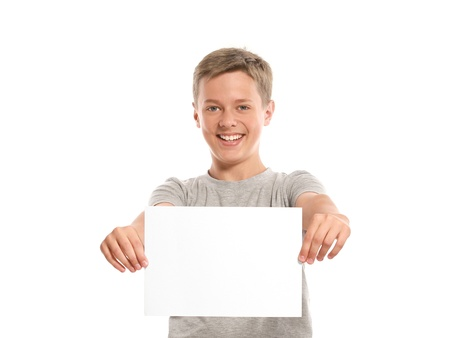 Smiling boy hold white blank paper. Isolated on white background