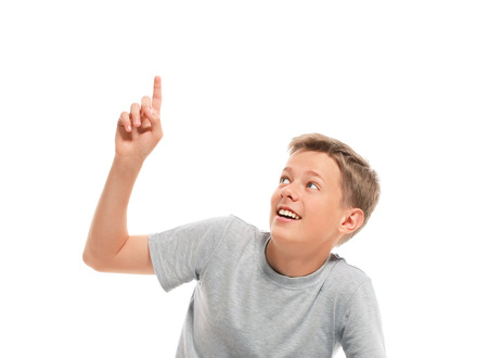 Teenage boy points up  Isolated on white