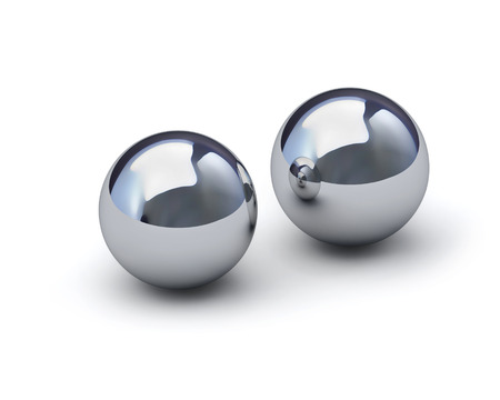 Two glossy metal spheres isolated on white with clipping path