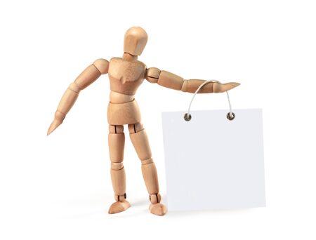 marioneta de madera: Hombre de madera que sostiene el cartel en blanco sobre blanco, con trazado de recorte