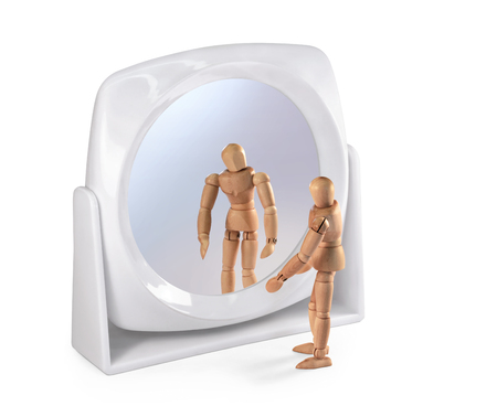 self conceit: Wooden man looking in a mirror on white, with clipping path