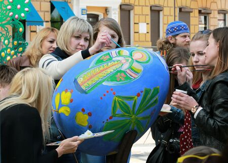 KYIV, UKRAINE - April 23, 2016. VI Ukrainian festival of Easter eggs. 374 Easter eggs in one and a half meters in height painted by masters-painters from all Ukrainian regions. Guests of the festival paint easter egg