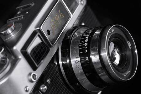 are fed: Kiev, Ukraine - May 12, 2016: Film camera FED 4, produced between 1969-1980 in Ukraine. Close up on black Editorial