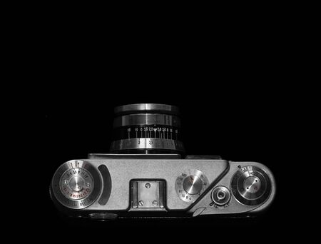 are fed: Kiev, Ukraine - May 12, 2016: Film camera FED 4, produced between 1969-1980 in Ukraine. Top view on black background