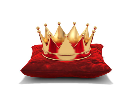 Gold crown on red velvet pillow isolated on white. 3D rendering 스톡 콘텐츠