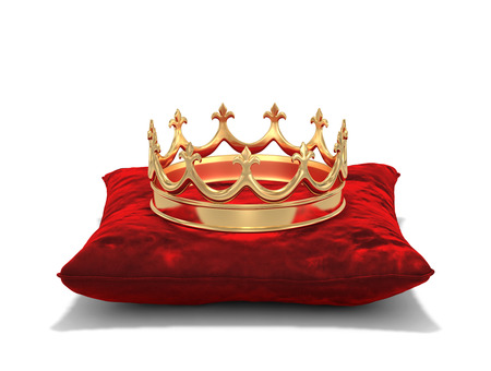 Gold crown on red velvet pillow isolated on white. 3D rendering with clipping path