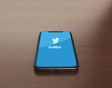 Kiev, Ukraine - January 4, 2018: 3D Render of a black iPhone X with mobile application of Twitter