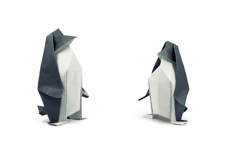 Two origami penguins isolated on white background. Clipping path included