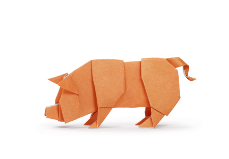 Origami paper pig isolated on white. Year of the pig. Clipping path included Фото со стока