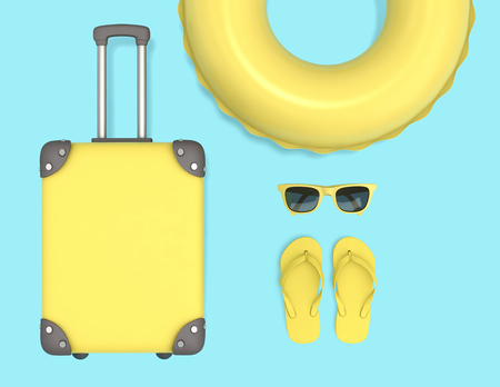 Summer vacation concept. Yellow suitcase, swimming ring, sunglasses and flip flops. Фото со стока