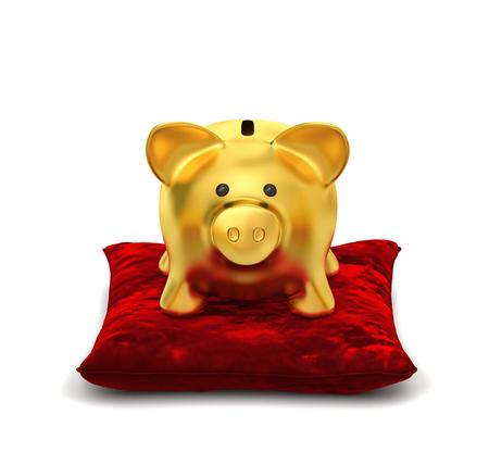 Golden piggy bank on red velvet pillow isolated on white.