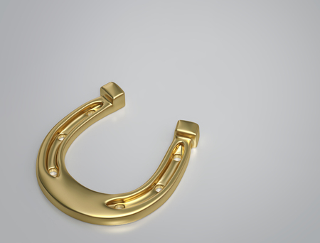 Golden horseshoe on gray background with copy space. Symbol of luck and happiness.  3D render