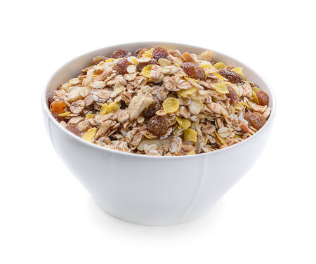 Breakfast - milk with chocolate corn flakes cereal in bowl photo