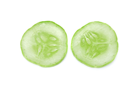 fresh cucumbers isolated on white background, macro photo