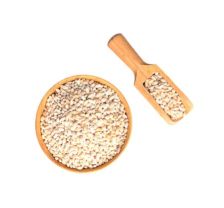 Barley grains isolated on a white background, photography