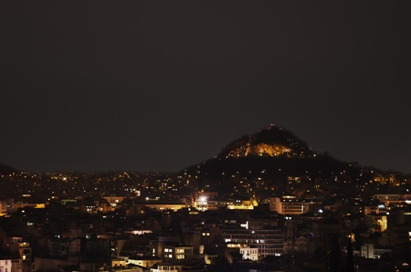 Nighttime view over Athens. The Lykavittos can be seen as a prominent feature in the picture.