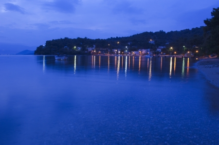Blue hour shot of the Neorion Bay at Poros in greece.