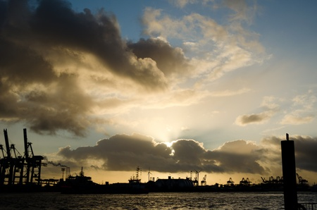 Sunset over the harbour of Hamburg, Germany Stock Photo - 17759822