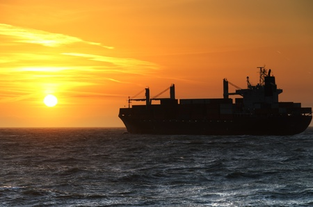 Container Ship cruising into the sunset on the North Sea