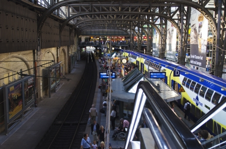 Travelers are waiting for the train in the central station of Hamburg.