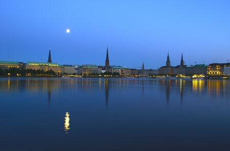 Night shot of the Binnenalster in Hamburg  The full moon is reflected in the water  photo
