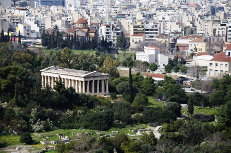 The Temple of Hephaestus is the best conserved ancient Greek temple in Athens  It forms a striking contrast to the modern city  Stock Photo