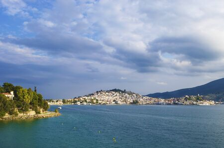 poros: The city of Poros in Greece as seen when approaching with the ferry from Athens  Stock Photo