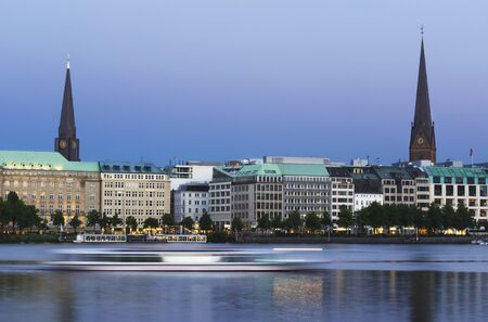 Long exposure evening shot of the Binnenalster in Hamburg  A ferry is blurred by its motion