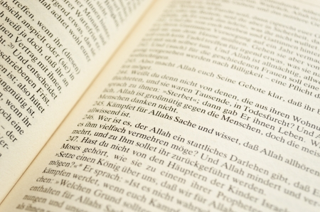 Page of a german translation of the Koran  Focus on the word Allah  Stock Photo