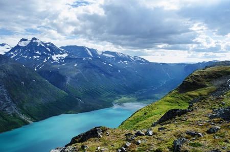 View towards the Gjende lake and the surrounding mountains in Jotunheimen national park in norway   The Gjende is supposed to be one of the most beautiful lakes in Norway