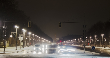 Winter traffic in Berlin  The Siegessäule can be seen in the background