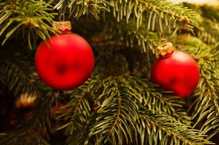 Christmas baubles on christmas tree  Warm light