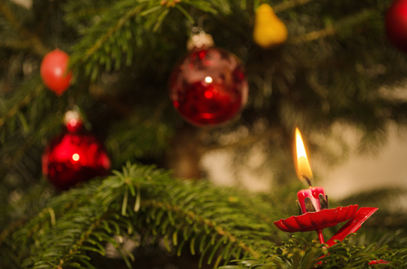 Decoration and candle on christmas tree  Warm light