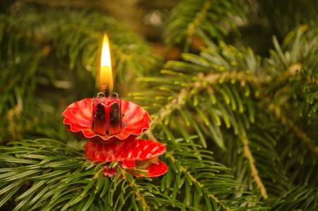 Candle on christmas tree  Warm light