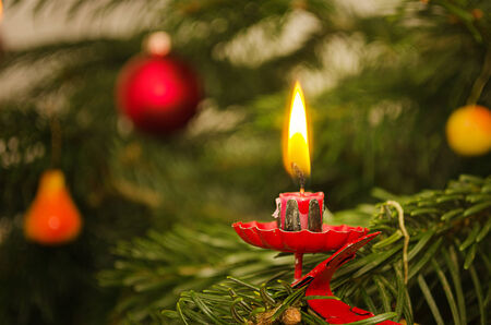Candle and traditional decoration on christmas tree