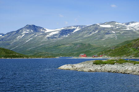 A lodge in Jotunheimen National Park in Norway at lake Bygdin  Stock Photo
