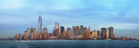 Panorama image of the financial district in Lower Manhattan, New York City in soft evening light  The new One World Trade Center can be seen as the highest building