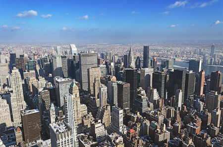Aerial shot of midtown manhattan  The Chrysler Building and the Brooklyn Bridge can be seen