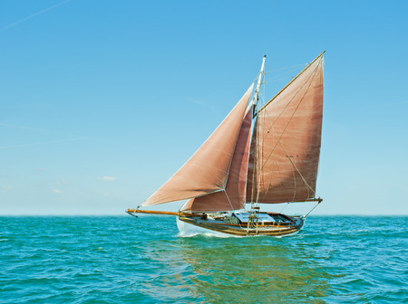 Old sailing boat on the Baltic Sea on a sunny day.