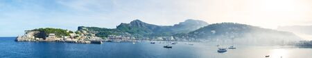 Panoramic image of Port de Sller on the Iceland Mallorca in Spain. Early morning shot with crap rising from the sea.