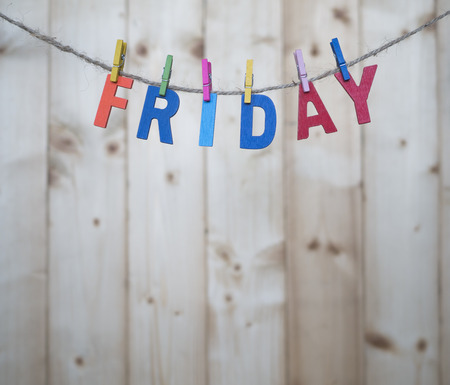 weekdays: Friday word by wooden letters hang with rope on wood background (Weekdays word series)
