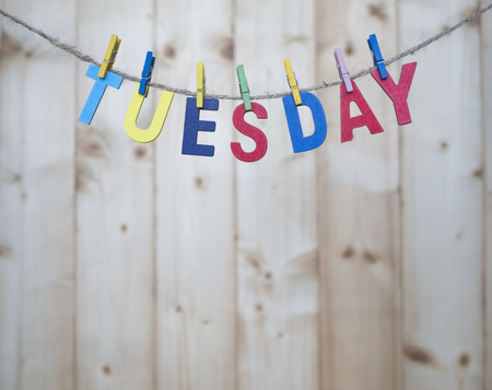 weekdays: Tuesday word by wooden letters hang with rope on wood background (Weekdays word series)