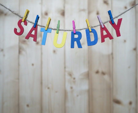 weekdays: Saturday word by wooden letters hang with rope on wood background (Weekdays word series) Stock Photo
