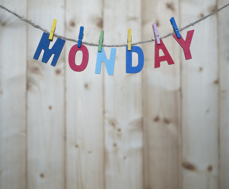 weekdays: Monday word by wooden letters hang with rope on wood background (Weekdays word series) Stock Photo