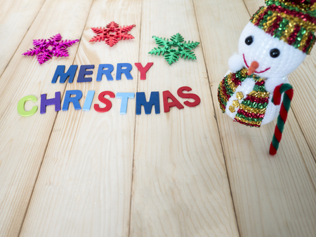 snowman wood: One Snowman with wooden font on wood background (Christmas Holiday)