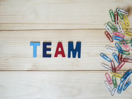 and spelling: Word spelling Team on wood background (Business concept)