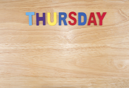 weekdays: Thursday word by wooden letters on wood background (Weekdays word series) Stock Photo