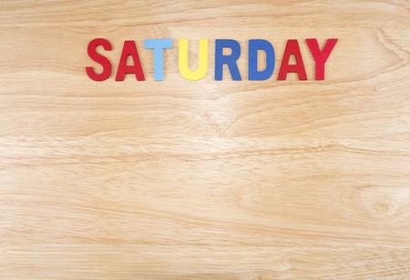 weekdays: Saturday word by wooden letters on wood background (Weekdays word series)