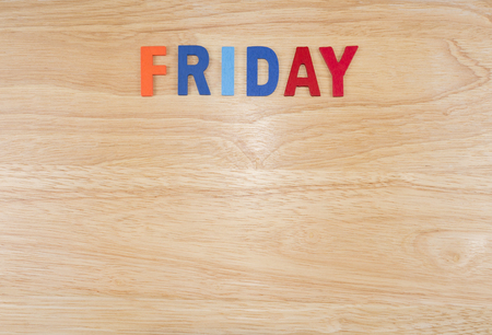 weekdays: Friday word by wooden letters on wood background (Weekdays word series)